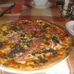 Photo taken at Oliva Étterem és Pizzéria by Вика Т. on 5/6/2013
