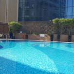 Photo taken at Majestic Hotel Dubai Rooftop Pool by Sasha V. on 11/14/2013