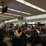 Photo taken at Gate 70 by Esat T. on 4/8/2013