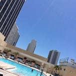 Photo taken at Hilton Hotel Rooftop Pool by Mindi L. on 5/5/2014