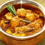 Photo taken at Kothur Indian Cuisine by TasteAway.com on 6/25/2013