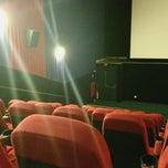 Photo taken at Grupo Cine by Julius C. on 10/14/2012