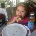 Photo taken at Juanito's Bakery & Cafe by Fressia P. on 9/28/2013