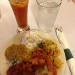 Photo taken at Indus Indian and Herbal Cuisine by Charlie F. on 2/11/2014
