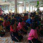 Photo taken at วัดรังษีสุทธาวาส (วัดไร่กล้วย) by Lyn L. on 9/23/2014