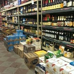 Photo taken at Sunset Beer Distributor by Aiko T. on 12/14/2013