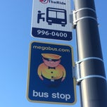Photo taken at Megabus Stop by PF A. on 7/24/2014