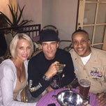 Photo taken at Churchill's Cigar Lounge by Michael M. on 10/18/2014