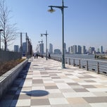 Photo taken at Pier 25 — Hudson River Park by Vic L. on 3/19/2012