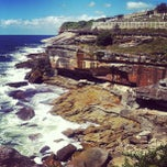Photo taken at Clovelly Beach by Ozan T. on 3/5/2013