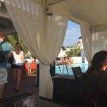Photo taken at Puro Beach by Doreen F. on 7/17/2014
