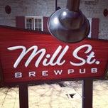 Photo taken at Mill St. Brew Pub by Alex M. on 3/20/2012