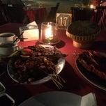 Photo taken at Kampung seafood Jimbaran by Irene T. on 10/12/2014