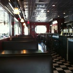 Photo taken at District 7 Grill by William M. on 5/9/2012