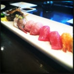 Photo taken at Okura Robata Sushi Bar and Grill by Lindsey G. on 5/6/2012