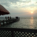 Photo taken at Dewey Destin's Seafood & Restaurant by Xi on 7/6/2012