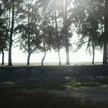 Photo taken at Pantai Puteri by John Mayor on 2/7/2012