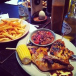 Photo taken at Nando's by rosie s. on 8/6/2012