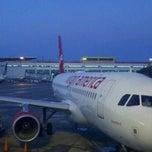 Photo taken at Gate 25 by Javier M. on 12/16/2011