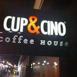 Photo taken at Cup & Cino Coffee House by thomas f. on 7/21/2011