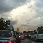 Photo taken at Persiaran Kewajipan Intersection by Derek C. on 2/8/2012