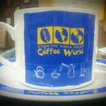 Photo taken at Coffee World (คอฟฟี่ เวิลด์) by Vika K. on 1/19/2012