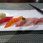 Photo taken at Xaga Sushi & Asian Fusion by Lisa S. on 12/31/2011