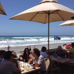 Photo taken at The Poseidon Restaurant on the Beach by Bob W. on 6/6/2012