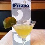 Photo taken at Fuzio Universal Bistro by Amanda S. on 7/20/2012