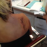 Photo taken at Sharp Images Tattoo Studio by Rachel H. on 7/31/2012