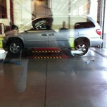 Photo taken at Discount Tire® Store by Chuck K. on 4/24/2012