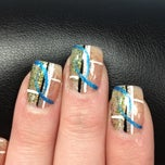 Photo taken at Cuticles Nail Salon by Cleo L. on 2/22/2012