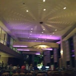 Photo taken at Caribe Hilton Lobby Bar by Ann Michele L. on 4/12/2012