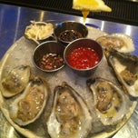Photo taken at Oceanaire Seafood Room by Olivia R. on 5/6/2012