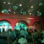 Photo taken at Mambo Cafe by Erika A. on 7/28/2012