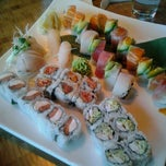Photo taken at Blue Moon Asian Grill & Sushi Bar by Ashley T. on 3/19/2012
