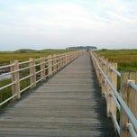 Photo taken at Silver Sands State Park Boardwalk by Curt R. on 8/24/2012