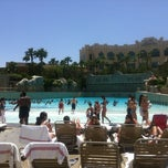 Photo taken at Mandalay Bay Beach by Anna F. on 5/19/2012