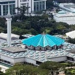 Photo taken at Masjid Negara (National Mosque) by Huzaifah R. on 2/17/2012