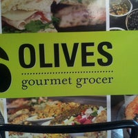 Photo taken at Olives Gourmet Grocer by Barry M. on 6/26/2012