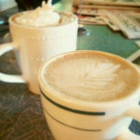Photo taken at Otherlands Coffee Bar & Exotic Gifts by Kristy C. on 5/6/2012