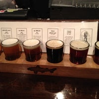 Photo taken at Dogfish Head Alehouse by Kelly A. on 3/16/2012