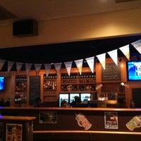 Photo taken at Sharp Edge Beer Emporium by Tyler S. on 10/2/2011