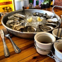Photo taken at Perla's Seafood and Oyster Bar by Michael C. on 8/12/2012