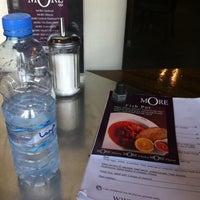 Photo taken at More Cafe Al Garhoud by Mathel U. on 7/9/2011