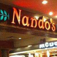 Photo taken at Nando's by Shamila H. on 7/11/2012
