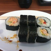 Photo taken at Sushi Factory by Kate M. on 2/19/2012