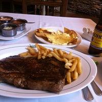 Photo taken at La Siesta Restaurant Bar by Ruben R. on 10/4/2012