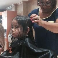Photo taken at Rizo's Beauty Salon by Yvette M. on 7/12/2015