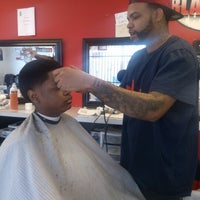 Photo taken at CJ's Fades From The Blades by Q Diva D. on 12/25/2012